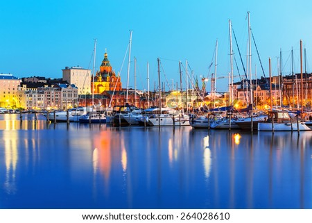 Scenic summer evening panorama of the Old Port pier and Uspenski Orthodox Cathedral in the Old Town in Helsinki, Finland - stock photo
