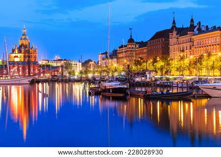 Scenic summer evening panorama of the Old Port pier architecture with tall historical sailing ships, yachts and boats and Uspenski Orthodox Cathedral in the Old Town in Helsinki, Finland - stock photo