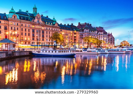 Scenic summer evening panorama of the Old Town (Gamla Stan) architecture pier with sightseeing travel ships and boats in Stockholm, Sweden - stock photo
