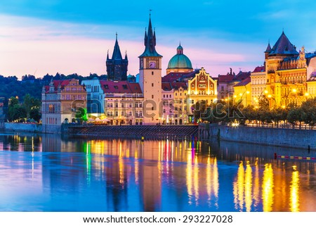 Scenic summer evening view of the Old Town ancient architecture and Vltava river pier in Prague, Czech Republic - stock photo