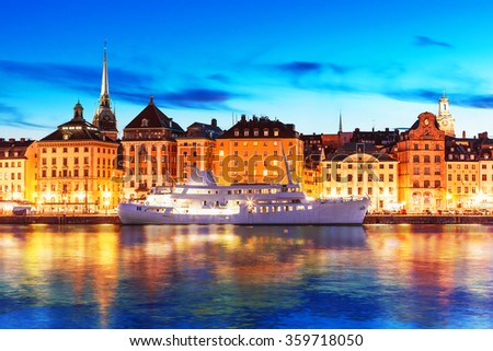 Scenic summer evening view of the Old Town (Gamla Stan) architecture pier in Stockholm, Sweden - stock photo