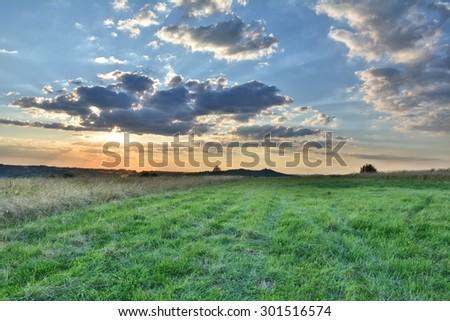 Scenic summer landscape of grasslands in Poland - stock photo