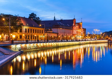 Scenic summer night view of the Old Town illuminated pier architecture in Wroclaw, Poland