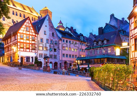 Scenic summer night view of the Old Town medieval architecture with half-timbered buildings in Nuremberg, Germany - stock photo