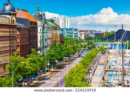 Scenic summer panorama of the Old Port architecture with yachts and historical tall ships at the Old Town pier in Helsinki, Finland - stock photo