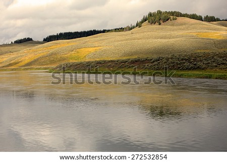 Scenic summer reflection in Yellowstone, Wyoming, USA. - stock photo