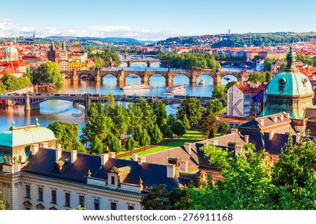 Scenic summer sunset aerial view of the Old Town pier architecture and Charles Bridge over Vltava river in Prague, Czech Republic - stock photo