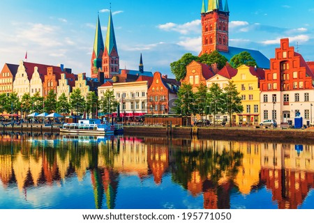 Scenic summer sunset view of the Old Town pier architecture in Lubeck, Germany - stock photo