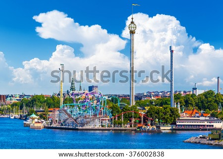 Scenic summer view of amusement park with attractions and rides on Djurgarden island in Stockholm, Sweden - stock photo