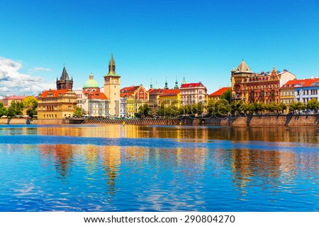 Scenic summer view of the Old Town ancient architecture and Vltava river pier in Prague, Czech Republic - stock photo