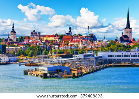 Scenic summer view of the Old Town architecture and sea port harbor in Tallinn, Estonia
