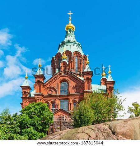 Scenic summer view of Uspenski Orthodox Christian Cathedral Church in Helsinki, Finland - stock photo