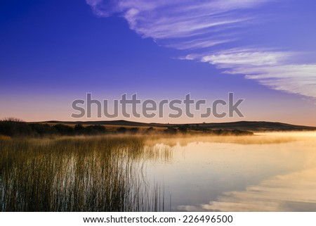 Scenic summer views of a prairie lake at sunset and sunrise, Police Outpost Provincial Park Alberta Canada - stock photo