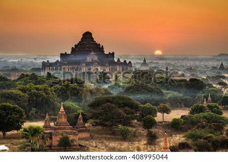 Scenic sunrise above Bagan in Myanmar. Bagan is an ancient city with thousands of historic buddhist temples and stupas. - stock photo