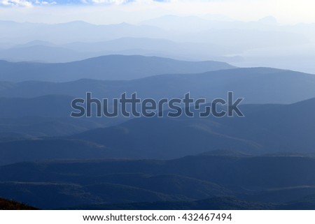 scenic sunrise in the mountains, the gradation of color clouds and fog mountain ranges