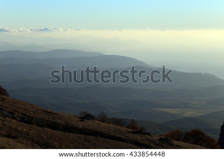 scenic sunrise in the mountains, the gradation of color clouds and fog mountain ranges - stock photo