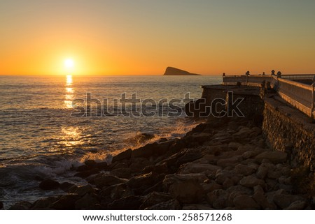 Scenic sunrise over Benidorm bay, one of Europes top  beach resort destinations - stock photo