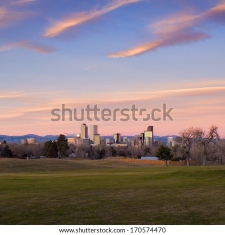 Scenic sunrise with pink clouds over downtown Denver, Colorado. Super wide angle. - stock photo