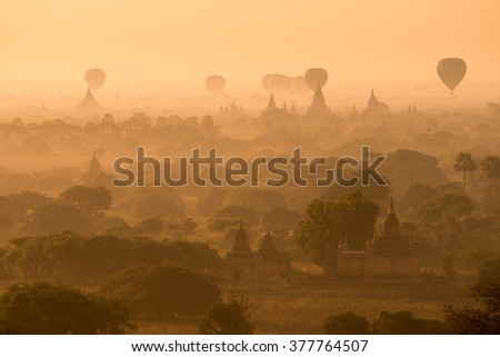 Scenic sunset at bagan myanmar. Group of balloons fly over pagoda. This activity is done everyday in Bagan