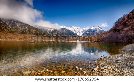 Scenic Taisho Pond and Hodaka Mountain range in Kamikochi, which is located in the Chubu-Sangaku National Park in Japan.