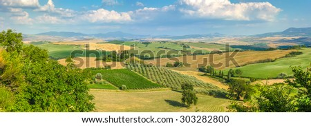 Scenic Tuscany landscape with rolling hills and valleys in golden evening light, Val d'Orcia, Italy