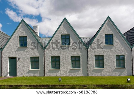 Scenic valley and a village in Thingvellir National Park - famous area in Iceland - stock photo