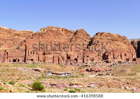Scenic View Ancient Nabataean Rock-Cut Royal Tombs Complex on Rose Red Color Mountains in The Lost City of Petra, Jordan - stock photo