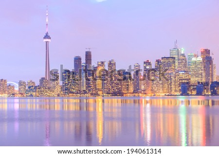Scenic view at Toronto city water front skyline at twilight. - stock photo