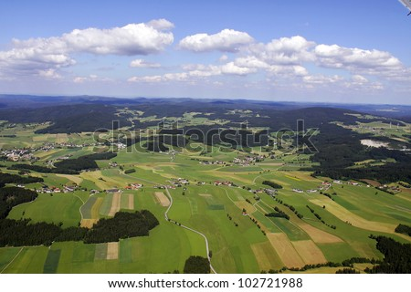 scenic view from an airplane. meadows, fields and fields - stock photo