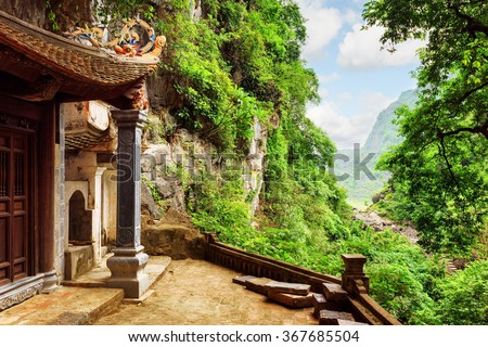Scenic view from the Bich Dong Pagoda at Ninh Binh Province in Vietnam. Ancient Buddhist cave temple is a popular tourist destination of Asia
