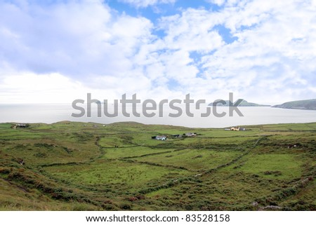 scenic view in kerry ireland of fields coastline and skellig rock - stock photo