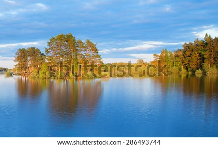 Scenic view of a calm lake in Sweden at sunset - stock photo