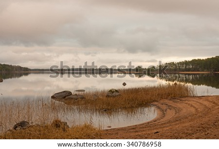 Scenic view of a calm lake landscape after the sunset - stock photo
