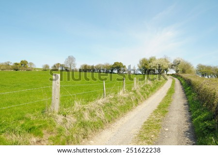 Scenic View of a Country Track through Farmland - stock photo
