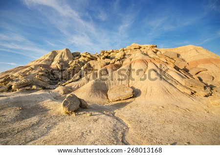 Scenic view of a desertic landscape at sunset in Bardenas Reales, Navarra, Spain. - stock photo