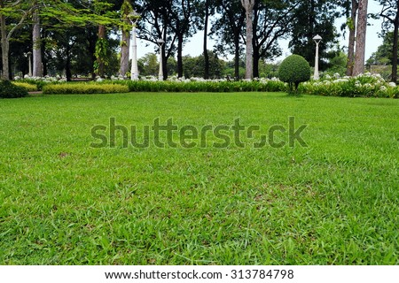 Scenic View of a Lawn in a Peaceful Green Park - stock photo