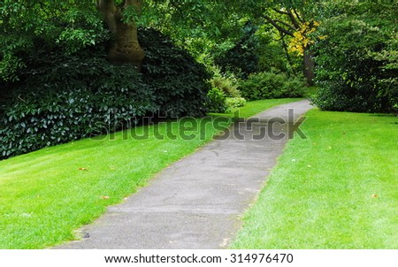 Scenic View of a Pathway through a Peaceful City Park - stock photo