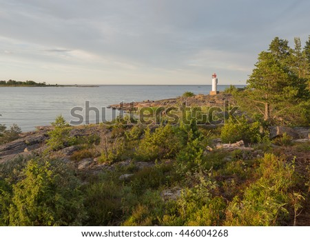 Scenic view of a rocky coast in sunset - stock photo