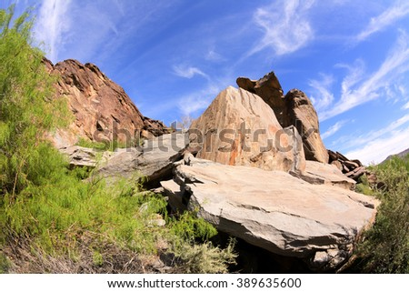 Scenic view of a slate rock mountainside framed against a blue sky. Shot in Palm Springs, California.Mo