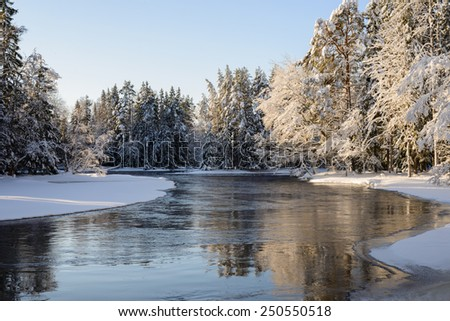Scenic view of a sunlight river in winter - stock photo