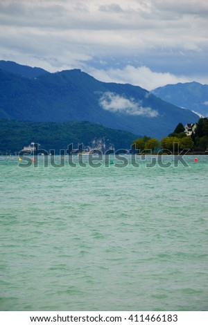 Scenic view of Annecy lake (Haute-Savoie, France) in the evening. Annecy Lake is known as Europe's cleanest lake.