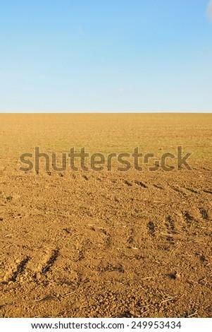 Scenic View of Bare Earth on a Farmland Field - stock photo