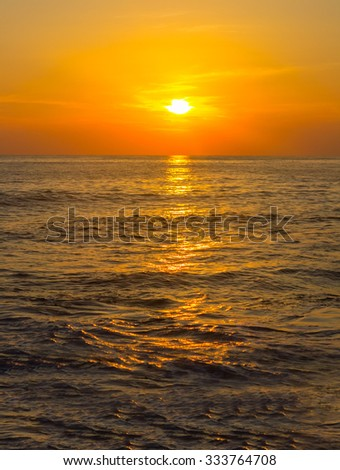 Scenic view of beautiful sunset above the sea - stock photo