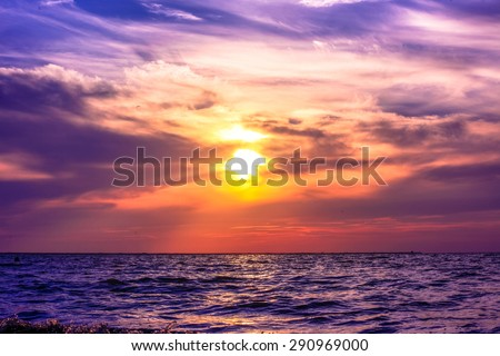 Scenic view of beautiful sunset above the sea in purple colors - stock photo