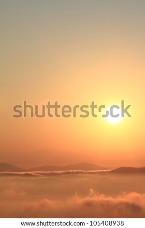 Scenic view of beautiful sunset over the mountains - stock photo