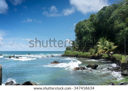 Scenic view of coast against sky, Trinidad And Tobago - stock photo