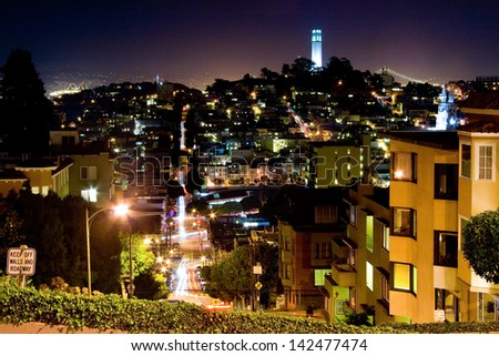 Scenic view of Coit tower viewed from Lombard Street at night, San Francisco, California, U.S.A. - stock photo
