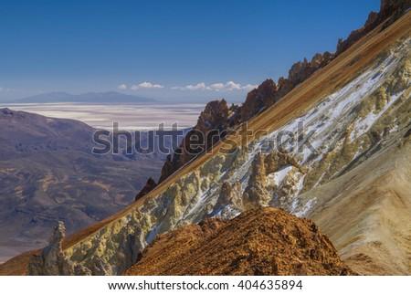 Scenic view of colored mountain slopes above Salar de Uyuni in Bolivia - stock photo