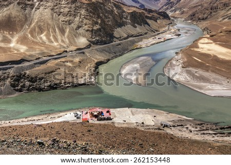 Scenic view of Confluence of Zanskar and Indus rivers - Leh, Ladakh, Jammu and Kashmir, India, travel, water, nature, turn, change, waterbody, canyon, chadar, trek, flow, curve, scenic, valley, view - stock photo