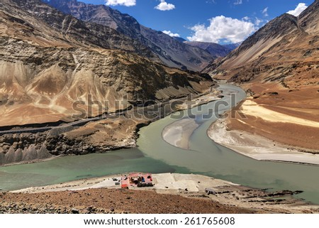 Scenic view of Confluence of Zanskar river from left and Indus rivers from up right - Leh, Ladakh, Jammu and Kashmir, India. tourist spot, all seasons. landscape, scenic, beautiful, aerial view,  - stock photo